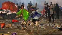 Protesters hurl stones during a riot near the Election Supervisory Agency (Bawaslu) headquarters in Jakarta, May 22, 2019. Demonstrations over the outcome of last month's presidential election gripped the heart of Indonesia's capital on Wednesday (May 22)