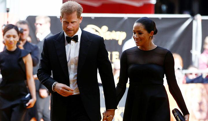 "Pangeran Harry bersama Meghan Markle, Duchess of Sussex saat menghadiri premiere film ""The Lion King"" di London, 14 Juli 2019. REUTERS/Henry Nicholls"
