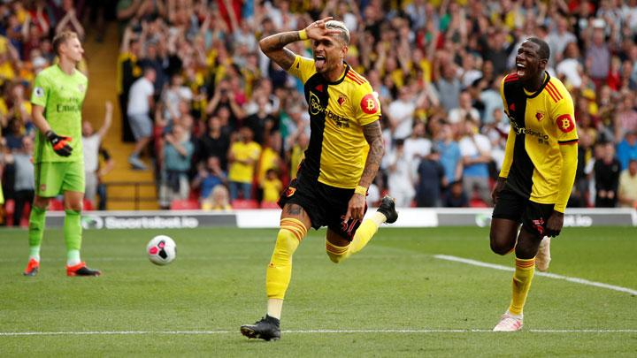 Pemain Watford Roberto Pereyra, melakukan selebrasi usai mencetak gol ke gawang Arsenal dalam pertandingan Liga Inggris di Vicarage Road, Watford, 15 September 2019. Action Images via Reuters/John Sibley